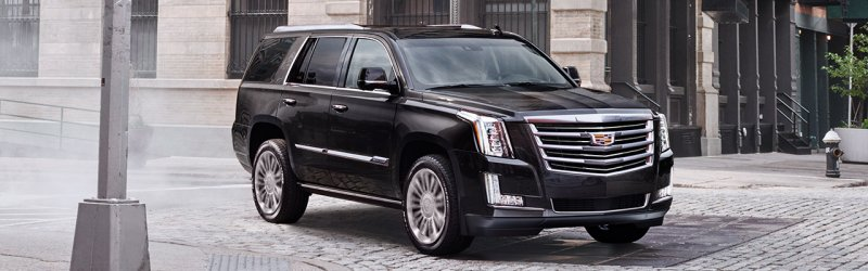 2017-escalade-gallery-exterior-passenger-side-black-cornering-1280x400.jpg